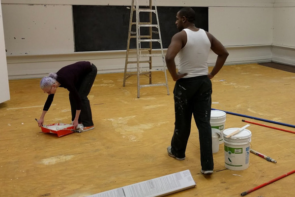 Volunteer Hadley Dean helping out in our first months to paint classrooms with Board Member Travis Alvarez