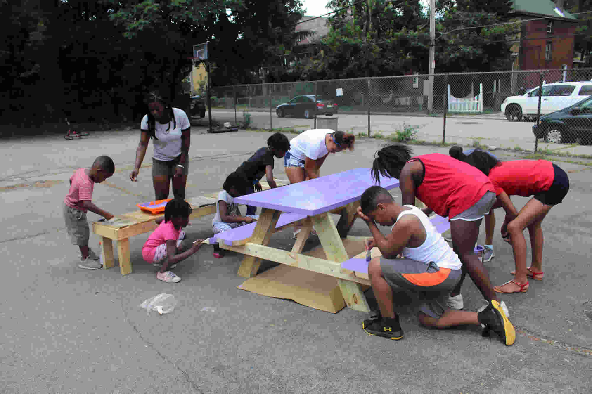 Neighborhood youth helped us write a grant for a day to clean-up the playground and build picnic benches.